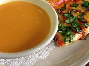 Carrot Ginger Soup with a slice of Vegetarian Pizza